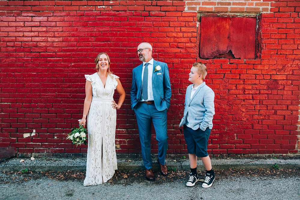 wedding portrait red brick wall