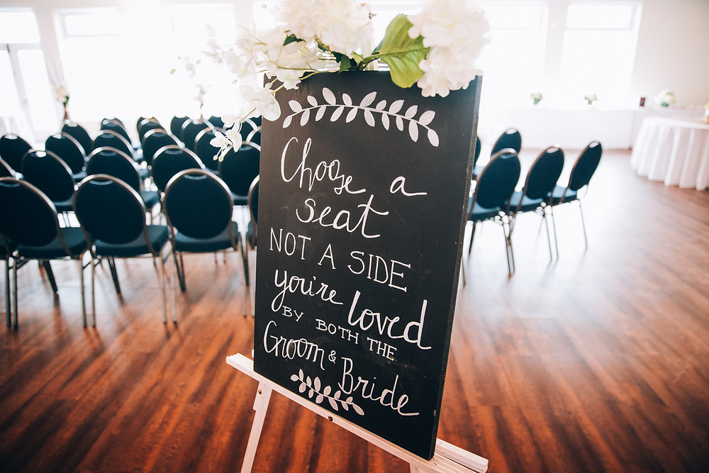 Choose a seat not a side sign at wedding