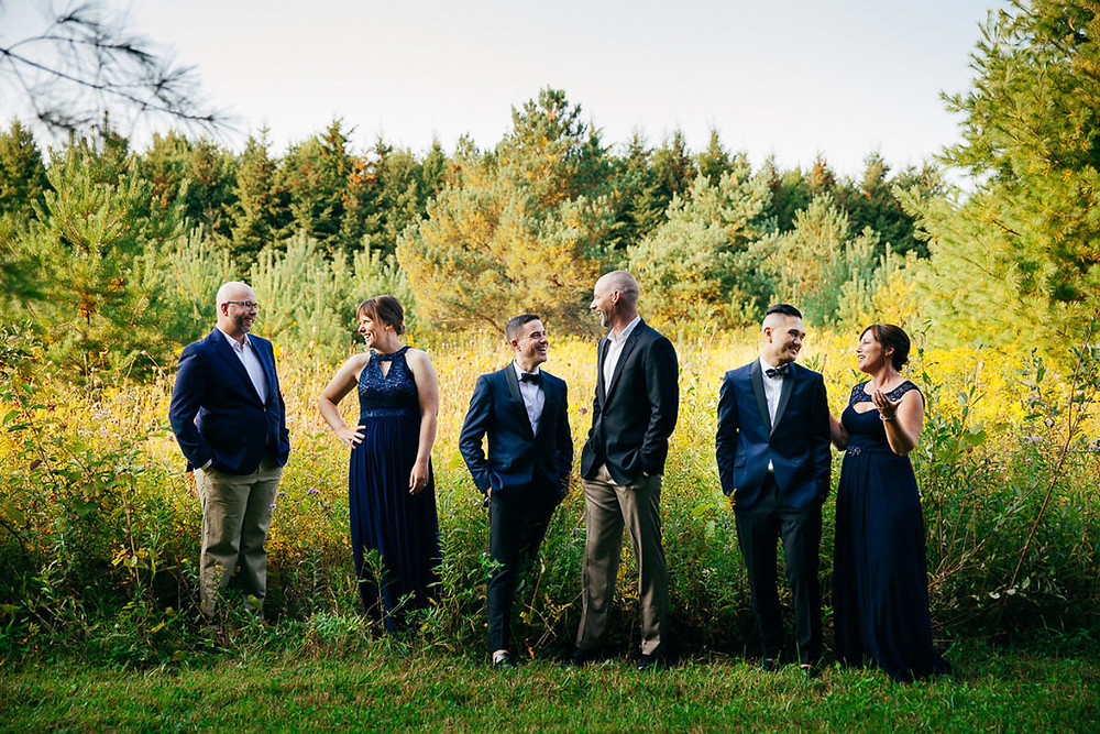 wedding party photos in a field
