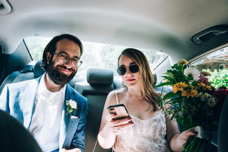 bride and groom in Uber in Toronto