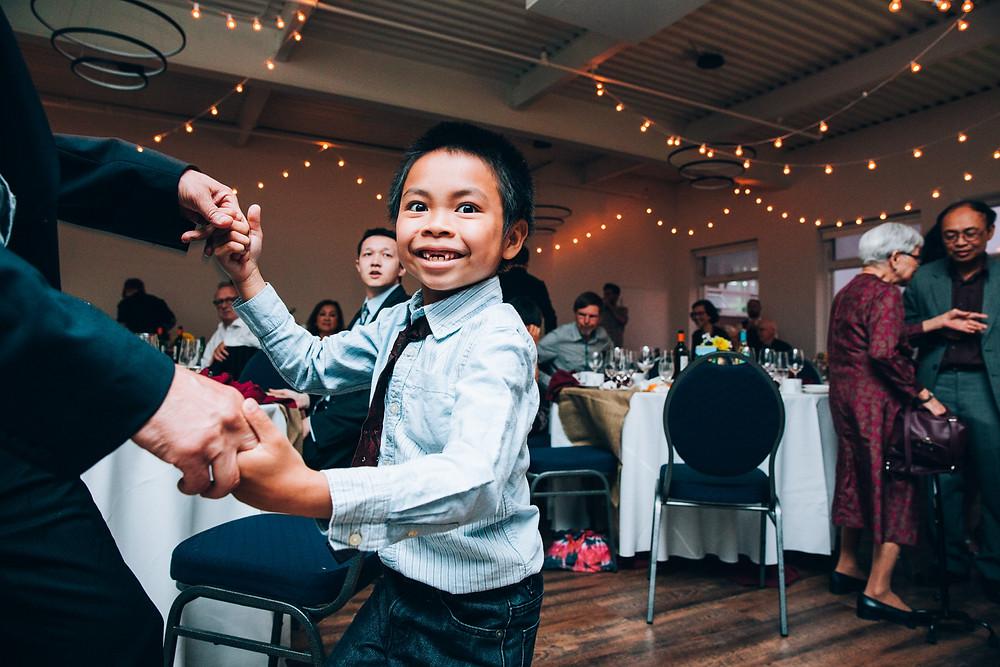 young boy dancing at a wedding
