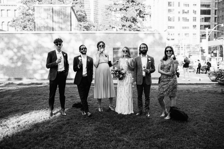 portrait of wedding party eating icecream in downtown Toronto