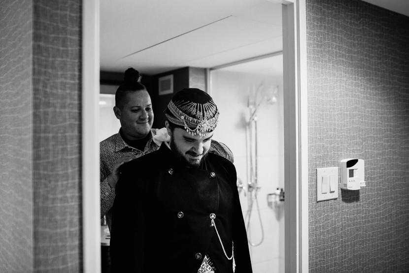groom in hotel room before the wedding