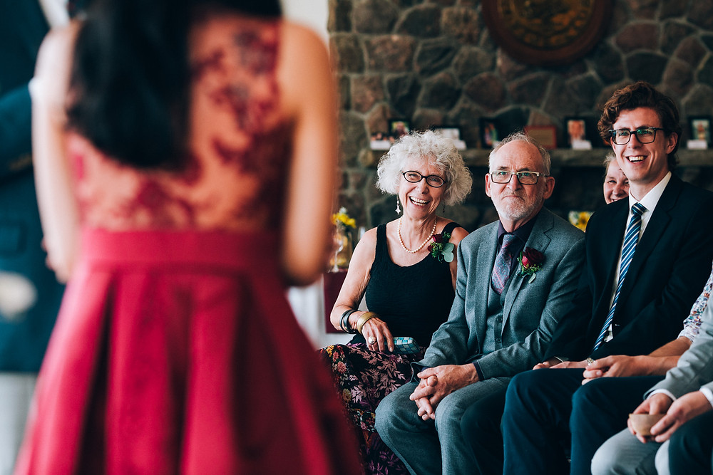 parents smiling during wedding ceremony