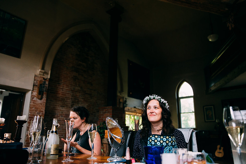 bride getting ready in converted church