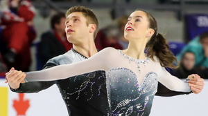 Trennt Michaud and Evelyn Walsh performing a spread eagle in one of their skating programs