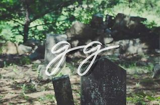 Image of an overgrown graveyard  with the letters gg in script font
