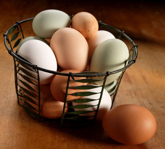 food styling a basket of eggs