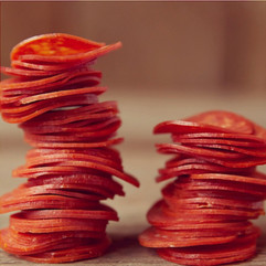 Stacks of pepperoni food styled