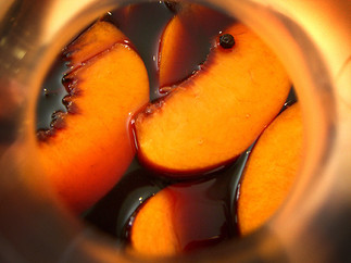 food styling peaches in wine