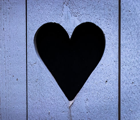 Heart%20shaped%20hole%20in%20wooden%20do