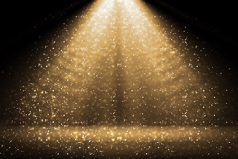 Stage light and golden glitter lights on