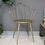 Thumbnail: Chaise papillon doré