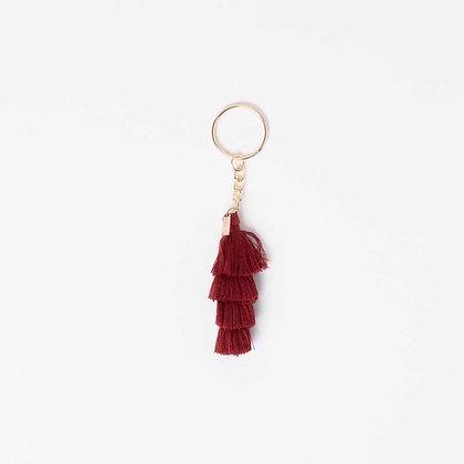 Porte clés à pompon rouge