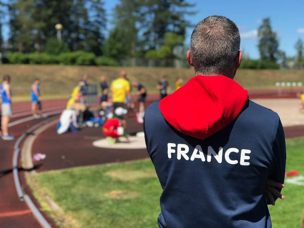 Mathieu Defosse watches on whilst one of his young Para Athletes prepares for competition during the European Para Youth Games in Pajulahti, Finland