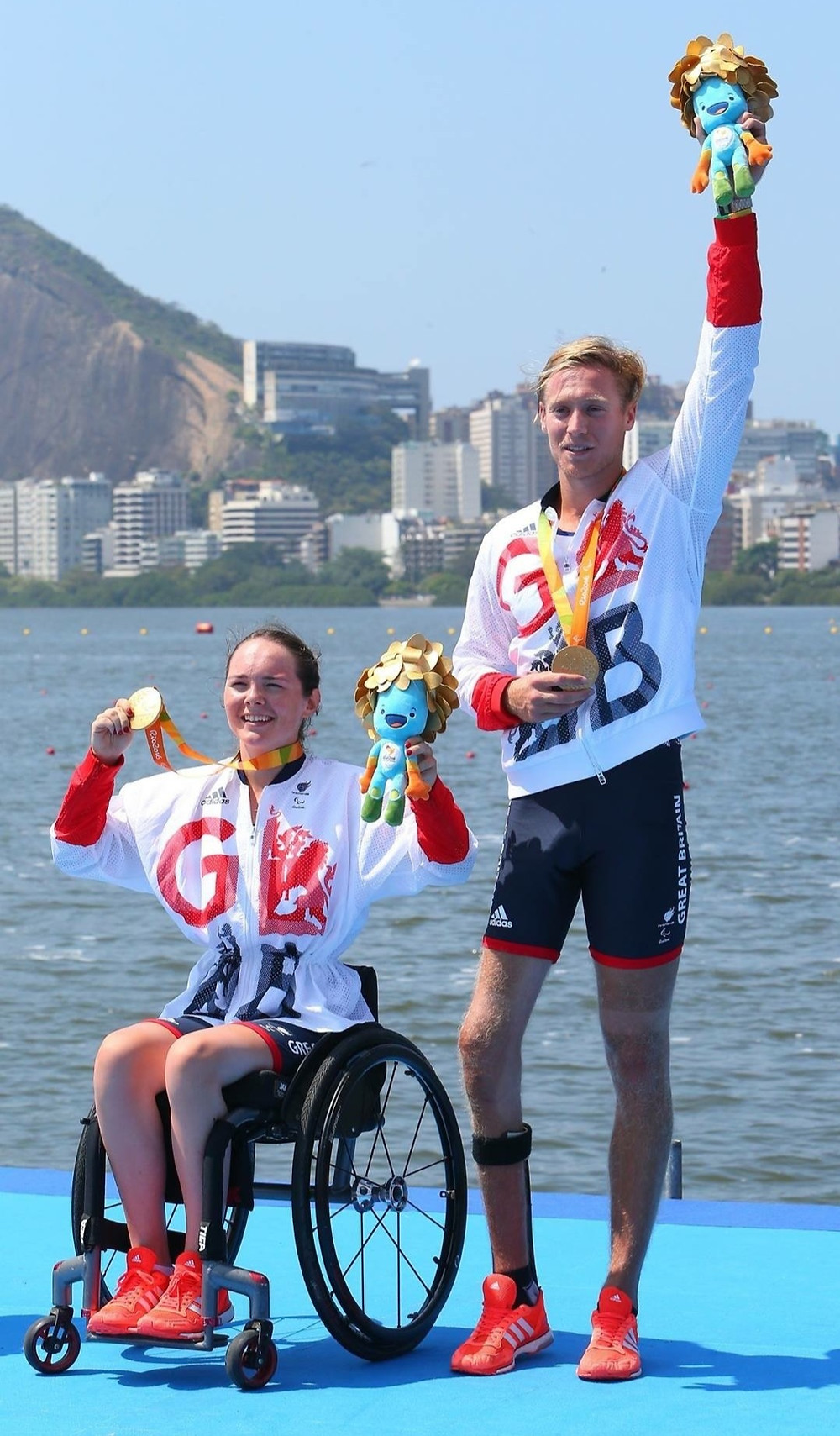 Lauren Rowles celebrates winning gold with Laurence Whiteley for Great Britain in the trunk-arms mixed double scull (TAMix2x) at the Rio 2016 Paralympic Games.