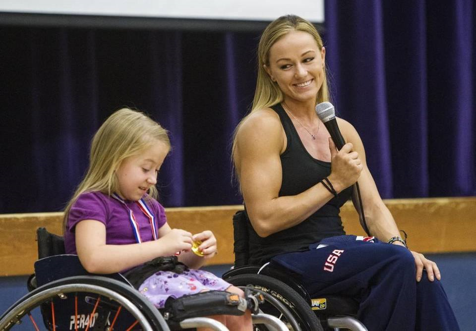 US Paralympian Megan Blunk with a young wheelchair athlete I Interview with Parasports World