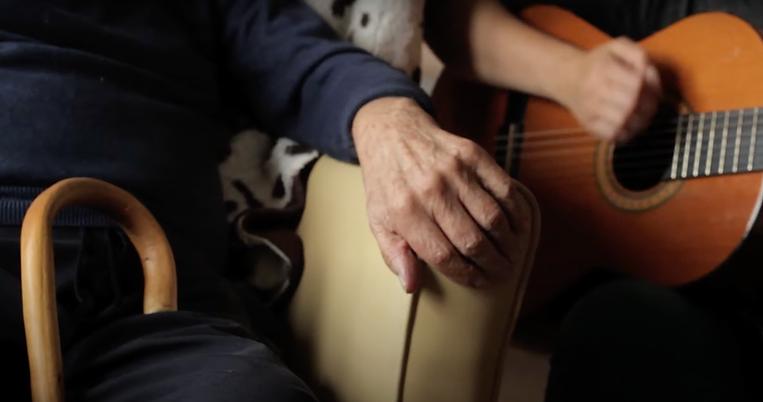 John Offen Hand + Guitar.png