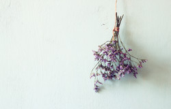 bouquet of dried flowers hanging on rope