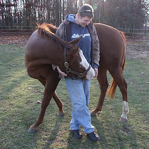 Kristi and horse named Spirit Standing-6-Feet-Strong