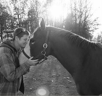 Kristi and horse named Spirit at Spirit's Whisper Ranch