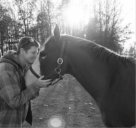 Kristi and horse named Spirit at Spirit's Whisper Ranch