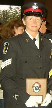 Kristi in Police uniform - Spirit's Whisper Ranch
