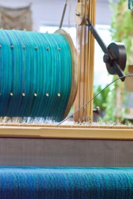 Raanu handwoven artisan made fashion loom. Handmade upcycled clothing.