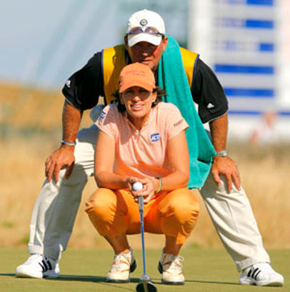 Worth and Julie lining up putt.jpg