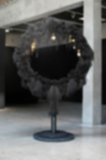 """Mourning Wreath (detail), 2017. Synthetic and human hair, found hair, artist's hair, gold leaf on copper, enamel paint, chain, wire frame, cement base. 8'9""""H x 6'W x 36""""DIA BASE"""