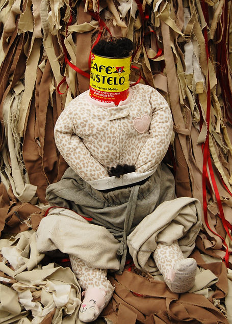 """Juan: Ya Lo Sé Que Tú Te Vas"" Un bolero de soledad (detail), Cafe Bustelo can, coffee, artist's hair, father's prison uniform, ribbon, fabric, and stools. 6.3' x  2.5'. 2017"