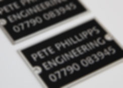Stainless steel nameplate, black background engraved and chemically etched