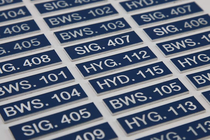 Blue and white laser engraved tags