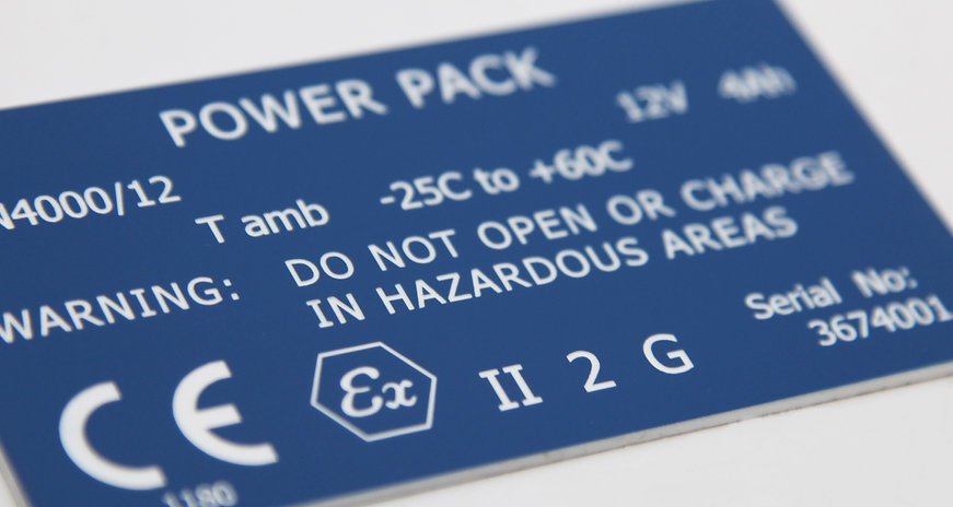 Blue and white traffolyte type ridge plastic label laser engraved