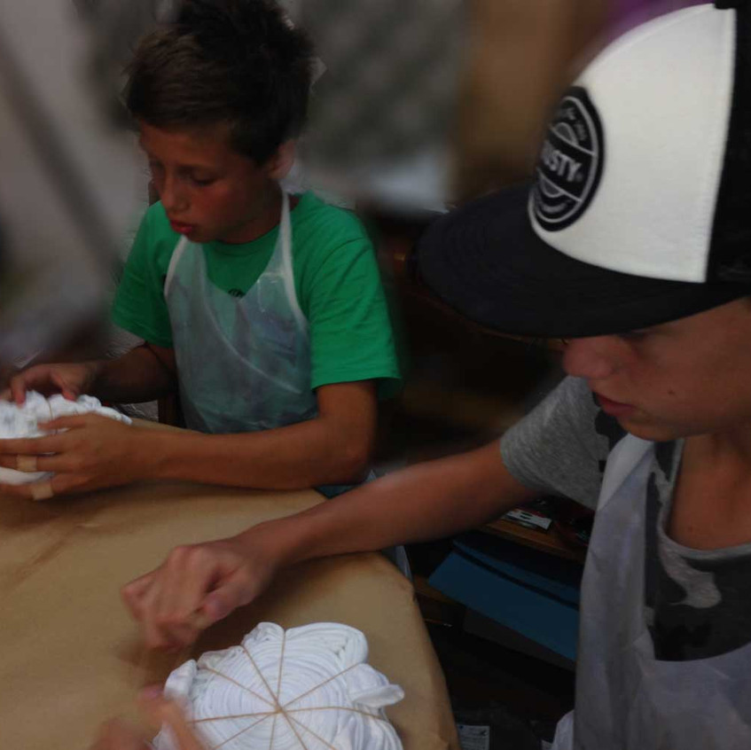 teen boys tie dyeing