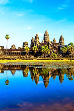 The ancient Angkor Wat temple is reflect