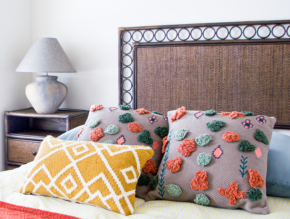 Colourful cushions in bedroom