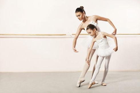Little ballerina dancing with ballet tea