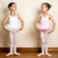 Young ballet dancer in a studio with woo
