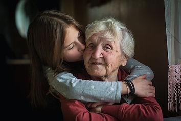 A little girl hugs her grandmother..jpg