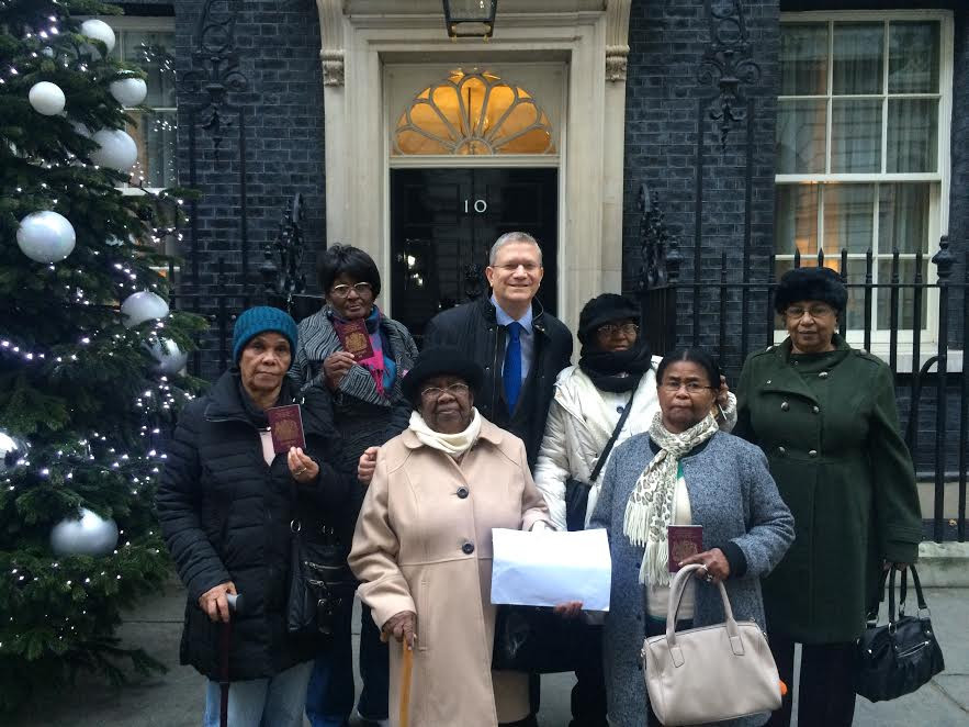 Conservative MP and Chair of All-Party Parliamentary Group on the Chagos Islands Andrew Rosindell hands in a letter to Theresa May with 6 native-born Chagossian women