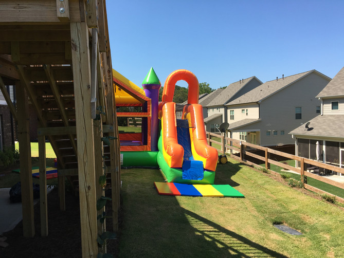 The Deluxe Castle Inflatable Bounce House Slide Combo