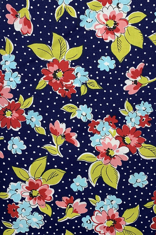 Pink and Red flowers on a Blue and White Pokadot Background