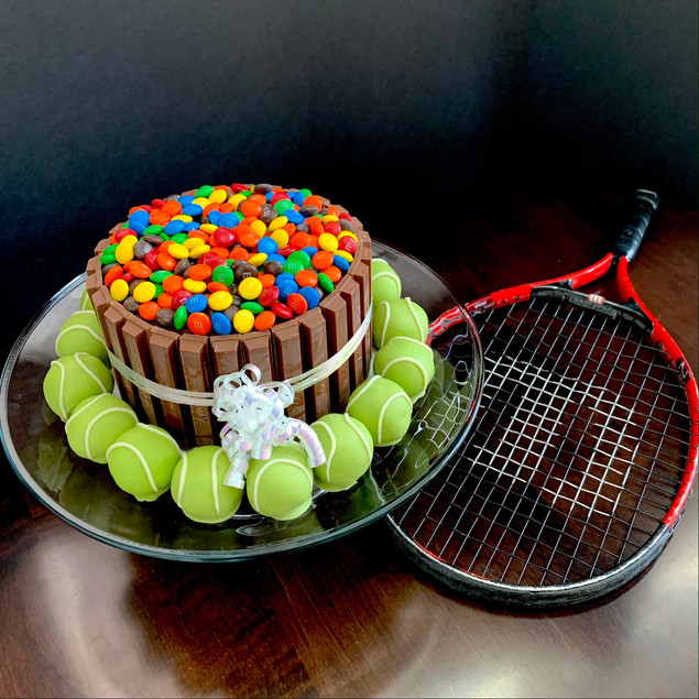 Candy bowl cake and tennis ball cookie dough bites