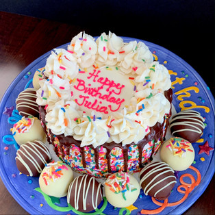 Sprinkle drip birthday cake with cake ball truffles and cookie dough bites