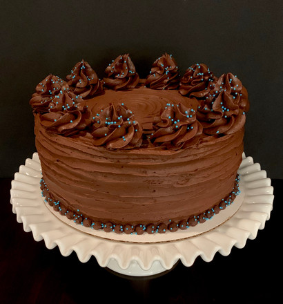 Chocolate cake with chocolate buttercream poufs