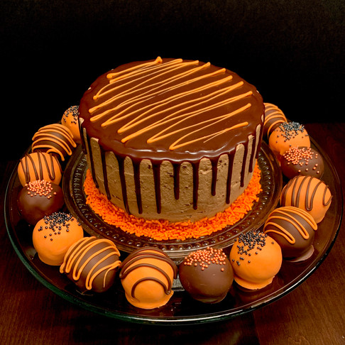 Halloween chocolate mousse drip cake with cake truffles and chocolate chip cookie dough bites