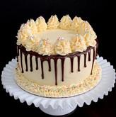 Cream cheese iced chocolate cake with chocolate drip