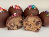Milk chocolate-dipped chocolate chip cookie dough bites