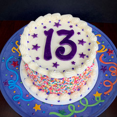 Sprinkle birthday cake with fondant number